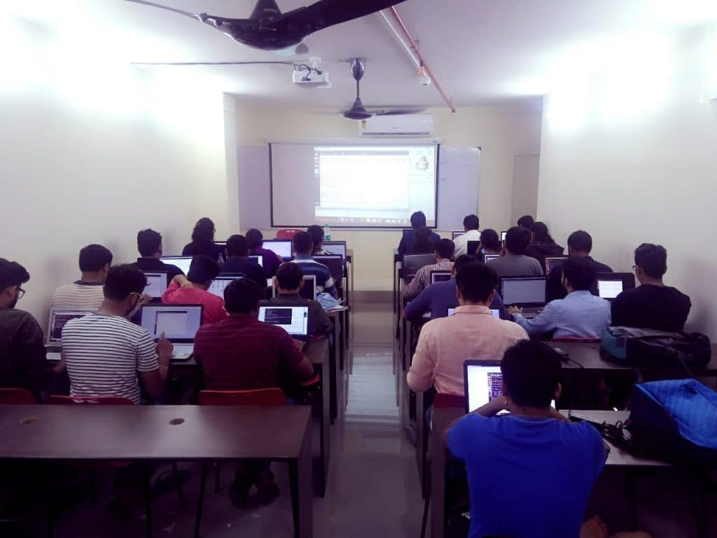 Students studies web languages at seminar room